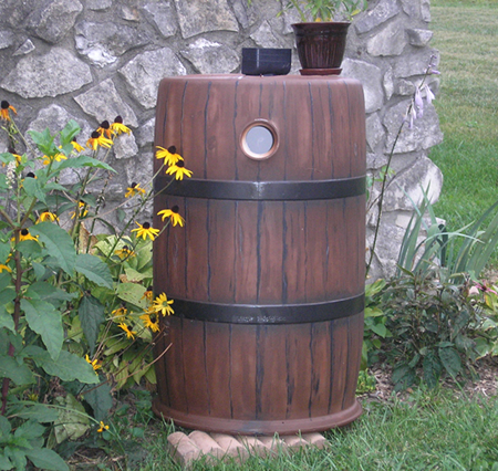 Painted rain barrel - to look like a whiskey barrel